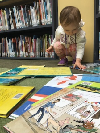Messing up any shelves at the library she could get her hands on.